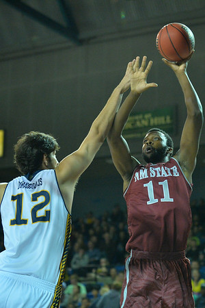 Jan 2, 2016: New Mexico State Aggies forward Johnathon Wilkins (11) shoots over UC Irvine Anteaters center Ioannis Dimakopoulos (12) in a game between New Mexico State and UC Irvine at the Bren Events Center in Irvine, Calif. The Anteaters defeated the Aggies 54-52.