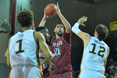 Jan 2, 2016: New Mexico State Aggies center Tanveer Bhullar (21) looks to put up a shot over UC Irvine Anteaters center Ioannis Dimakopoulos (12) in a game between New Mexico State and UC Irvine at the Bren Events Center in Irvine, Calif. The Anteaters defeated the Aggies 54-52.
