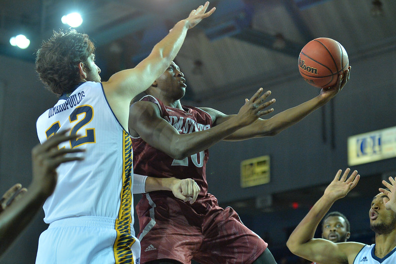 Jan 2, 2016: New Mexico State Aggies guard Sidy Ndir (20) drives to the basket in a game between New Mexico State and UC Irvine at the Bren Events Center in Irvine, Calif. The Anteaters defeated the Aggies 54-52.