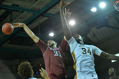 Jan 2, 2016: New Mexico State Aggies center Tanveer Bhullar (21) taps a rebound out to a teammate against UC Irvine Anteaters center Mamadou Ndiaye (34) in a game between New Mexico State and UC Irvine at the Bren Events Center in Irvine, Calif. The Anteaters defeated the Aggies 54-52.