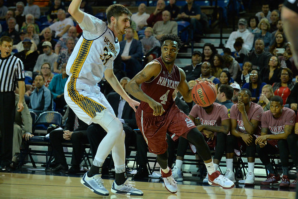 Jan 2, 2016: New Mexico State Aggies guard Ian Baker (4) looks to drive into the paint in a game between New Mexico State and UC Irvine at the Bren Events Center in Irvine, Calif. The Anteaters defeated the Aggies 54-52.