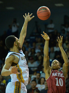 Jan 2, 2016: New Mexico State Aggies guard Rashawn Browne (10) shoots over a UC Irvine Anteaters defender in a game between New Mexico State and UC Irvine at the Bren Events Center in Irvine, Calif. The Anteaters defeated the Aggies 54-52.