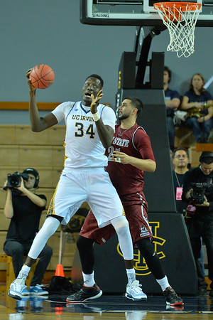 Jan 2, 2016: UC Irvine Anteaters center Mamadou Ndiaye (34) backs into the post against New Mexico State Aggies center Tanveer Bhullar (21) in a game between New Mexico State and UC Irvine at the Bren Events Center in Irvine, Calif. The Anteaters defeated the Aggies 54-52.