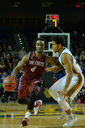 Jan 2, 2016: New Mexico State Aggies guard Ian Baker (4) drives past his defender in a game between New Mexico State and UC Irvine at the Bren Events Center in Irvine, Calif. The Anteaters defeated the Aggies 54-52.