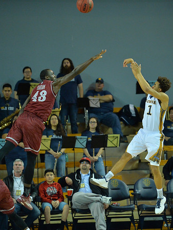 Jan 2, 2016: New Mexico State Aggies forward Pascal Siakam (43) contests a shot by UC Irvine Anteaters guard Alex Young (1) in a game between New Mexico State and UC Irvine at the Bren Events Center in Irvine, Calif. The Anteaters defeated the Aggies 54-52.