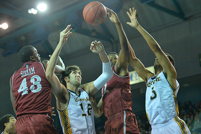 Jan 2, 2016: New Mexico State Aggies forward Johnathon Wilkins (11) battles for a rebound against UC Irvine Anteaters forward Jonathan Galloway (5) and UC Irvine Anteaters center Ioannis Dimakopoulos (12) in a game between New Mexico State and UC Irvine at the Bren Events Center in Irvine, Calif. The Anteaters defeated the Aggies 54-52.