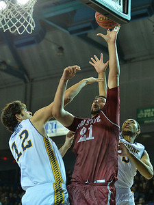 Jan 2, 2016: New Mexico State Aggies center Tanveer Bhullar (21) puts up a shot over UC Irvine Anteaters center Ioannis Dimakopoulos (12) in a game between New Mexico State and UC Irvine at the Bren Events Center in Irvine, Calif. The Anteaters defeated the Aggies 54-52.