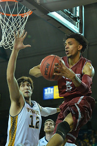 Jan 2, 2016: New Mexico State Aggies guard Matt Taylor (5) looks to pass to a teammate in a game between New Mexico State and UC Irvine at the Bren Events Center in Irvine, Calif. The Anteaters defeated the Aggies 54-52.