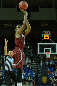 Jan 2, 2016: New Mexico State Aggies guard Ian Baker (4) shoots a three pointer in a game between New Mexico State and UC Irvine at the Bren Events Center in Irvine, Calif. The Anteaters defeated the Aggies 54-52.