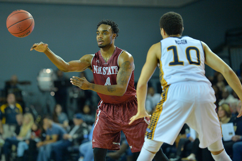 Jan 2, 2016: New Mexico State Aggies guard Ian Baker (4) throws a pass to a teammate in a game between New Mexico State and UC Irvine at the Bren Events Center in Irvine, Calif. The Anteaters defeated the Aggies 54-52.