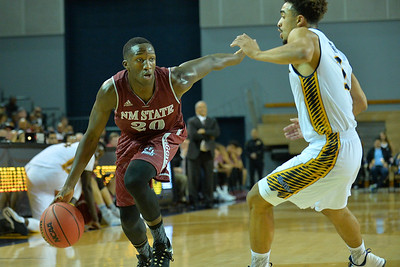 Jan 2, 2016: New Mexico State Aggies guard Sidy Ndir (20) looks to drive past UC Irvine Anteaters forward Jonathan Galloway (5) in a game between New Mexico State and UC Irvine at the Bren Events Center in Irvine, Calif. The Anteaters defeated the Aggies 54-52.