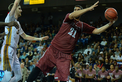 Jan 2, 2016: New Mexico State Aggies center Tanveer Bhullar (21) saves a ball as he falls out of bounds in a game between New Mexico State and UC Irvine at the Bren Events Center in Irvine, Calif. The Anteaters defeated the Aggies 54-52.