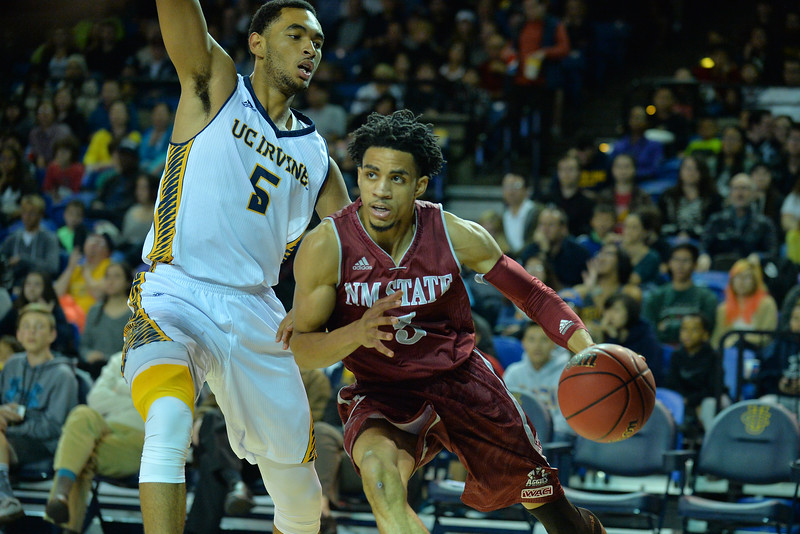Jan 2, 2016: New Mexico State Aggies guard Matt Taylor (5) drives past UC Irvine Anteaters forward Jonathan Galloway (5) in a game between New Mexico State and UC Irvine at the Bren Events Center in Irvine, Calif. The Anteaters defeated the Aggies 54-52.
