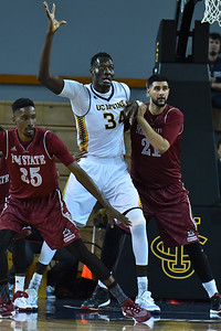 Jan 2, 2016: New Mexico State Aggies center Tanveer Bhullar (21) guards UC Irvine Anteaters center Mamadou Ndiaye (34) in the low post in a game between New Mexico State and UC Irvine at the Bren Events Center in Irvine, Calif. The Anteaters defeated the Aggies 54-52.