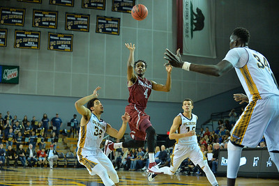 Jan 2, 2016: New Mexico State Aggies guard Ian Baker (4) throws a lob pass into the paint in a game between New Mexico State and UC Irvine at the Bren Events Center in Irvine, Calif. The Anteaters defeated the Aggies 54-52.