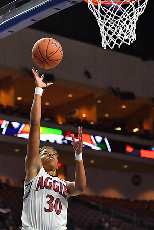 LAS VEGAS, NV - MARCH 07:  Gia Pack #30 of the New Mexico State Aggies gets a layup against the Chicago State Cougars during a quarterfinal game of the Western Athletic Conference basketball tournament at the Orleans Arena in Las Vegas, Nevada. The Aggies won 84-60.