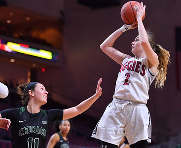 LAS VEGAS, NV - MARCH 07:  Brooke Salas #2 of the New Mexico State Aggies shoots against Konner Harris #11 of the Chicago State Cougars during a quarterfinal game of the Western Athletic Conference basketball tournament at the Orleans Arena in Las Vegas, Nevada. The Aggies won 84-60.