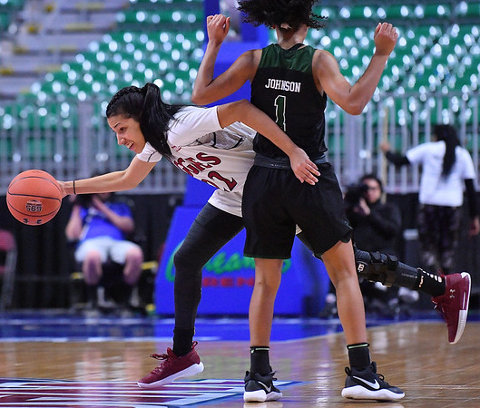 LAS VEGAS, NV - MARCH 07:  Kalei Atkinson #22 of the New Mexico State Aggies dribbles around Phylicia Johnson #1 of the Chicago State Cougars during a quarterfinal game of the Western Athletic Conference basketball tournament at the Orleans Arena in Las Vegas, Nevada. The Aggies won 84-60.