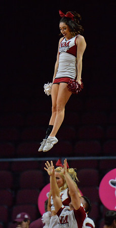 LAS VEGAS, NV - MARCH 07:  A New Mexico State Aggies cheerleader performs during the team's game against the Chicago State Cougars during a quarterfinal game of the Western Athletic Conference basketball tournament at the Orleans Arena in Las Vegas, Nevada. The Aggies won 84-60.