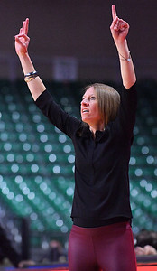 LAS VEGAS, NV - MARCH 07:  Head coach Brooke Atkinson of the New Mexico State Aggies calls a play during her team's game against the Chicago State Cougars during a quarterfinal game of the Western Athletic Conference basketball tournament at the Orleans Arena in Las Vegas, Nevada. The Aggies won 84-60.
