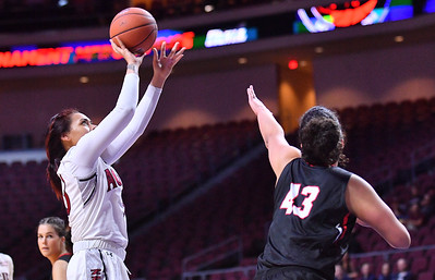 LAS VEGAS, NV - MARCH 09:  Jeneva Toilolo #33 of the New Mexico State Aggies shoots against Joana Alves #43 of the Seattle Redhawks during a semifinal game of the Western Athletic Conference basketball tournament at the Orleans Arena in Las Vegas, Nevada. Seattle won 84-61.