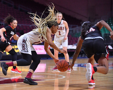 LAS VEGAS, NV - MARCH 09:  Zaire Williams #12 of the New Mexico State Aggies battles for a loose ball against Alexis Montgomery #24 of the Seattle Redhawks during a semifinal game of the Western Athletic Conference basketball tournament at the Orleans Arena in Las Vegas, Nevada. Seattle won 84-61.