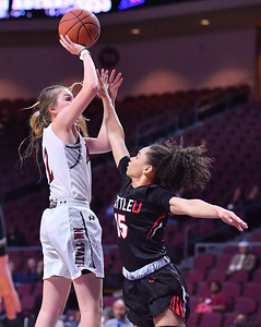 LAS VEGAS, NV - MARCH 09:  Brooke Salas #2 of the New Mexico State Aggies shoots against Kamira Sanders #15 of the Seattle Redhawks during a semifinal game of the Western Athletic Conference basketball tournament at the Orleans Arena in Las Vegas, Nevada. Seattle won 84-61.