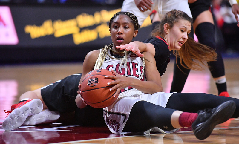 LAS VEGAS, NV - MARCH 09:  Zaire Williams #12 of the New Mexico State Aggies battles for a loose ball against Madeline Dopplick #23 of the Seattle Redhawks during a semifinal game of the Western Athletic Conference basketball tournament at the Orleans Arena in Las Vegas, Nevada. Seattle won 84-61.