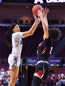 LAS VEGAS, NV - MARCH 09:  Monique Mills #21 of the New Mexico State Aggies shoots against Kamira Sanders #15 of the Seattle Redhawks during a semifinal game of the Western Athletic Conference basketball tournament at the Orleans Arena in Las Vegas, Nevada. Seattle won 84-61.