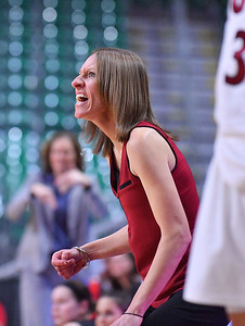LAS VEGAS, NV - MARCH 09:  Brooke Atkinson head coach of the New Mexico State Aggies shouts instructions to her team during a semifinal game of the Western Athletic Conference basketball tournament against the Seattle Redhawks at the Orleans Arena in Las Vegas, Nevada. Seattle won 84-61.