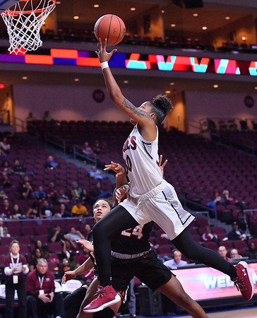 LAS VEGAS, NV - MARCH 09:  Gia Pack #30 of the New Mexico State Aggies drives for a layup against Alexis Montgomery #24 of the Seattle Redhawks during a semifinal game of the Western Athletic Conference basketball tournament at the Orleans Arena in Las Vegas, Nevada. Seattle won 84-61.