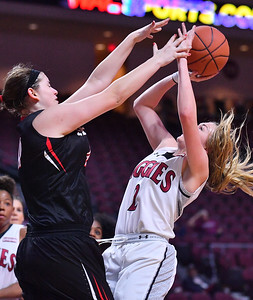 LAS VEGAS, NV - MARCH 09:  Brooke Salas #2 of the New Mexico State Aggies shoots against Kallin Spiller #41 of the Seattle Redhawks during a semifinal game of the Western Athletic Conference basketball tournament at the Orleans Arena in Las Vegas, Nevada. Seattle won 84-61.