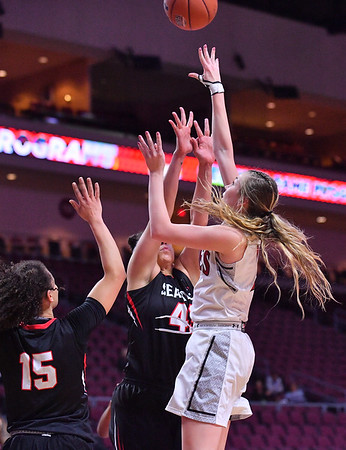 LAS VEGAS, NV - MARCH 09:  Brooke Salas #2 of the New Mexico State Aggies shoots against Kallin Spiller #41 and Kamira Sanders #15 of the Seattle Redhawks during a semifinal game of the Western Athletic Conference basketball tournament at the Orleans Arena in Las Vegas, Nevada. Seattle won 84-61.
