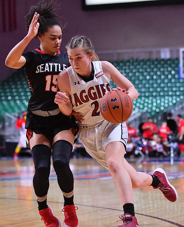 LAS VEGAS, NV - MARCH 09:  Brooke Salas #2 of the New Mexico State Aggies drives against Kamira Sanders #15 of the Seattle Redhawks during a semifinal game of the Western Athletic Conference basketball tournament at the Orleans Arena in Las Vegas, Nevada. Seattle won 84-61.