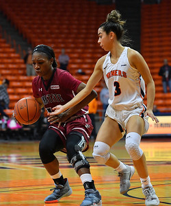EL PASO, TEXAS - NOVEMBER 23, 2019:  Nana Sule #14 of the New Mexico State Aggies dribbles against Katia Gallegos #3 of the UTEP Miners during their game at the Don Haskins Center on November 23, 2019 in El Paso, Texas. The Miners defeated the Aggies 65-45.  (Photo by Sam Wasson/bleedCrimson.net)