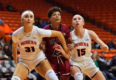EL PASO, TEXAS - NOVEMBER 23, 2019:  Tatyana Modawar #31 and Avery Crouse #15 of the UTEP Miners battle Aaliyah Prince #23 of the New Mexico State Aggies for rebounding position during their game at the Don Haskins Center on November 23, 2019 in El Paso, Texas. The Miners defeated the Aggies 65-45.  (Photo by Sam Wasson/bleedCrimson.net)
