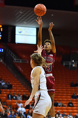 EL PASO, TEXAS - NOVEMBER 23, 2019:  Aaliyah Prince #23 of the New Mexico State Aggies shoots against Arina Khlopkova #1 of the UTEP Miners during their game at the Don Haskins Center on November 23, 2019 in El Paso, Texas. The Miners defeated the Aggies 65-45.  (Photo by Sam Wasson/bleedCrimson.net)