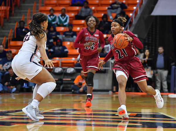 EL PASO, TEXAS - NOVEMBER 23, 2019:  Rodrea Echols #21 of the New Mexico State Aggies brings the ball up the court against Michelle Pruitt #33 of the UTEP Miners during their game at the Don Haskins Center on November 23, 2019 in El Paso, Texas. The Miners defeated the Aggies 65-45.  (Photo by Sam Wasson/bleedCrimson.net)