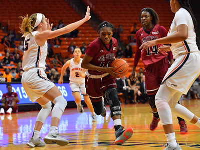 EL PASO, TEXAS - NOVEMBER 23, 2019:  Nana Sule #14 of the New Mexico State Aggies drives against Avery Crouse #15 of the UTEP Miners during their game at the Don Haskins Center on November 23, 2019 in El Paso, Texas. The Miners defeated the Aggies 65-45.  (Photo by Sam Wasson/bleedCrimson.net)