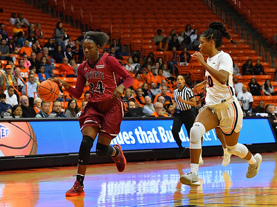 EL PASO, TEXAS - NOVEMBER 23, 2019:  Adenike Aderinto #24 of the New Mexico State Aggies drives against Jade Rochelle #10 of the UTEP Miners during their game at the Don Haskins Center on November 23, 2019 in El Paso, Texas. The Miners defeated the Aggies 65-45.  (Photo by Sam Wasson/bleedCrimson.net)