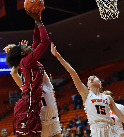EL PASO, TEXAS - NOVEMBER 23, 2019:  Adenike Aderinto #24 of the New Mexico State Aggies shoots against Avery Crouse #15 of the UTEP Miners during their game at the Don Haskins Center on November 23, 2019 in El Paso, Texas. The Miners defeated the Aggies 65-45.  (Photo by Sam Wasson/bleedCrimson.net)