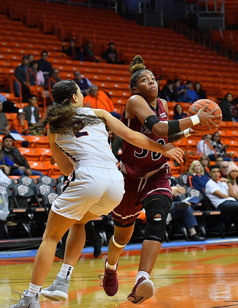 EL PASO, TEXAS - NOVEMBER 23, 2019:  Gia Pack #30 of the New Mexico State Aggies drives against Tia Bradshaw #2 of the UTEP Miners during their game at the Don Haskins Center on November 23, 2019 in El Paso, Texas. The Miners defeated the Aggies 65-45.  (Photo by Sam Wasson/bleedCrimson.net)