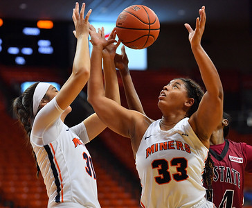 EL PASO, TEXAS - NOVEMBER 23, 2019:  Tatyana Modawar #31 and Michelle Pruitt #33 of the UTEP Miners battle for a rebound against Nana Sule #14 of the New Mexico State Aggies during their game at the Don Haskins Center on November 23, 2019 in El Paso, Texas.  (Photo by Sam Wasson/bleedCrimson.net)