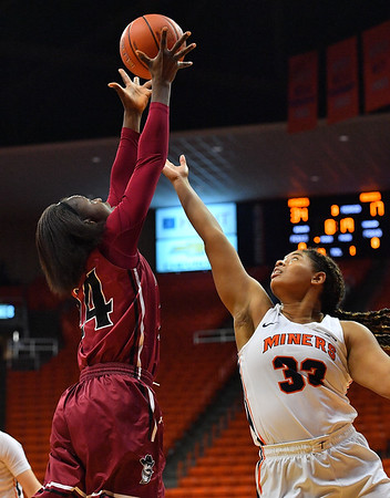 EL PASO, TEXAS - NOVEMBER 23, 2019:  Adenike Aderinto #24 of the New Mexico State Aggies grabs a rebound against Michelle Pruitt #33 of the UTEP Miners during their game at the Don Haskins Center on November 23, 2019 in El Paso, Texas. The Miners defeated the Aggies 65-45.  (Photo by Sam Wasson/bleedCrimson.net)