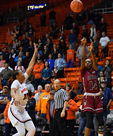 EL PASO, TEXAS - NOVEMBER 23, 2019:  Nana Sule #14 of the New Mexico State Aggies shoots against Ariona Gill #12 of the UTEP Miners during their game at the Don Haskins Center on November 23, 2019 in El Paso, Texas. The Miners defeated the Aggies 65-45.  (Photo by Sam Wasson/bleedCrimson.net)