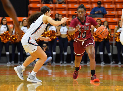 EL PASO, TEXAS - NOVEMBER 23, 2019:  Adrianna Henderson #10 of the New Mexico State Aggies dribbles against Ariona Gill #12 of the UTEP Miners during their game at the Don Haskins Center on November 23, 2019 in El Paso, Texas. The Miners defeated the Aggies 65-45.  (Photo by Sam Wasson/bleedCrimson.net)