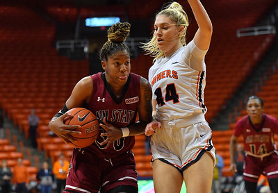 EL PASO, TEXAS - NOVEMBER 23, 2019:  Gia Pack #30 of the New Mexico State Aggies drives against Katarina Zec #44 of the UTEP Miners during their game at the Don Haskins Center on November 23, 2019 in El Paso, Texas. The Miners defeated the Aggies 65-45.  (Photo by Sam Wasson/bleedCrimson.net)