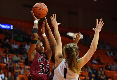 EL PASO, TEXAS - NOVEMBER 23, 2019:  Gia Pack #30 of the New Mexico State Aggies shoots against Arina Khlopkova #1 of the UTEP Miners during their game at the Don Haskins Center on November 23, 2019 in El Paso, Texas. The Miners defeated the Aggies 65-45.  (Photo by Sam Wasson/bleedCrimson.net)