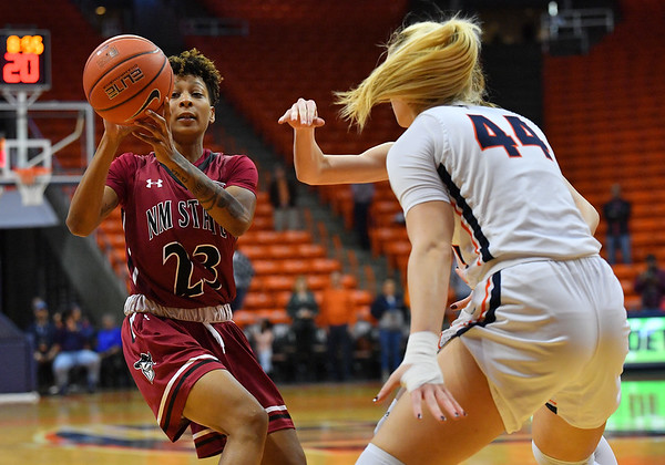 EL PASO, TEXAS - NOVEMBER 23, 2019:  Aaliyah Prince #23 of the New Mexico State Aggies passes against Katarina Zec #44 of the UTEP Miners during their game at the Don Haskins Center on November 23, 2019 in El Paso, Texas. The Miners defeated the Aggies 65-45.  (Photo by Sam Wasson/bleedCrimson.net)