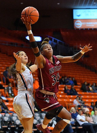 EL PASO, TEXAS - NOVEMBER 23, 2019:  Gia Pack #30 of the New Mexico State Aggies shoots against Tia Bradshaw #2 of the UTEP Miners during their game at the Don Haskins Center on November 23, 2019 in El Paso, Texas. The Miners defeated the Aggies 65-45.  (Photo by Sam Wasson/bleedCrimson.net)